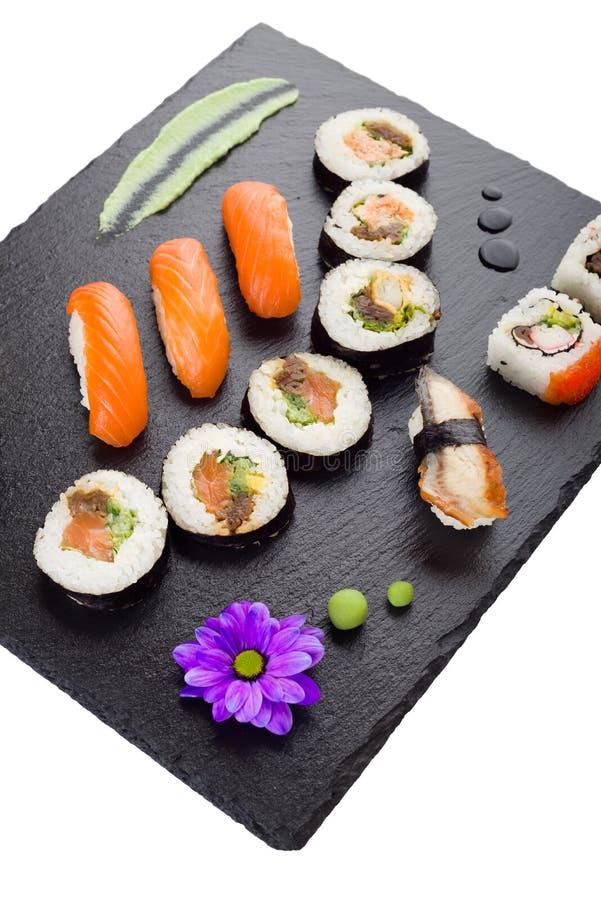 sushi on black stone plate isolated stock photo image of food
