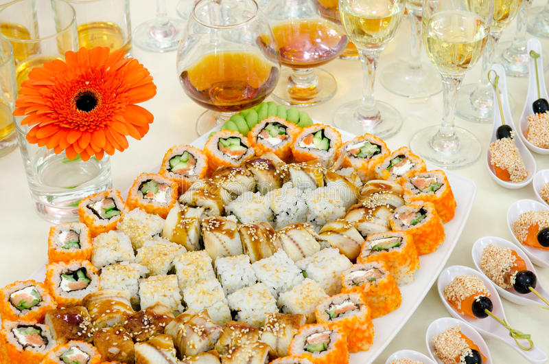 Sushi buffet table. A lot of sushi and drinks on buffet table, catering royalty free stock image
