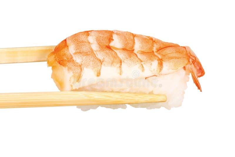 Sushi on chopsticks stock photography