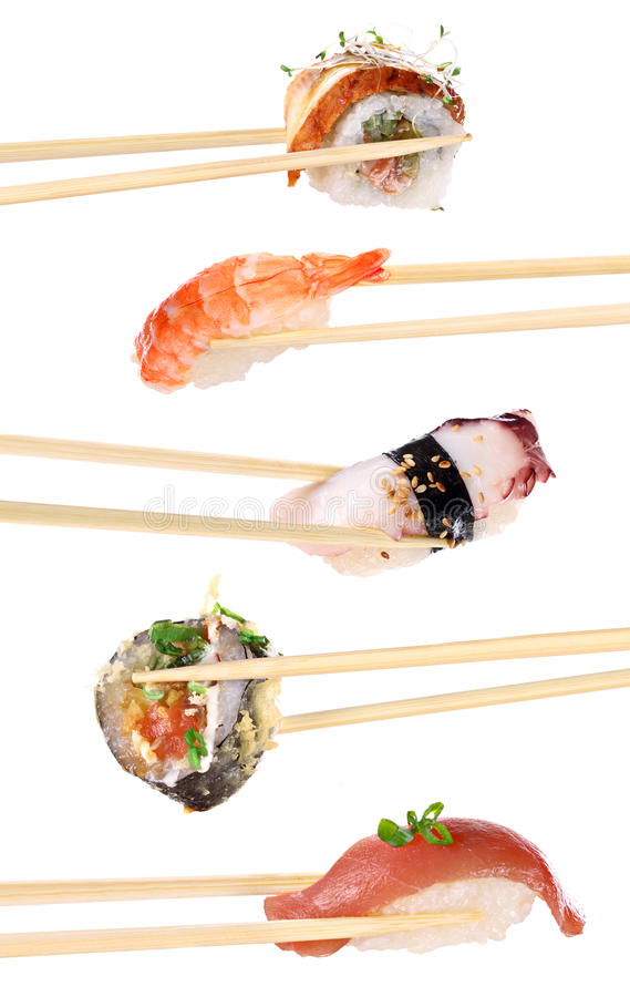 Sushi with chopsticks. Japanese sushi with white plate and chopsticks stock images