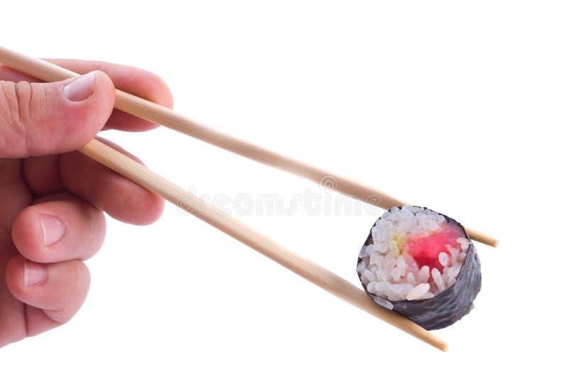 Sushi with chopsticks stock photos