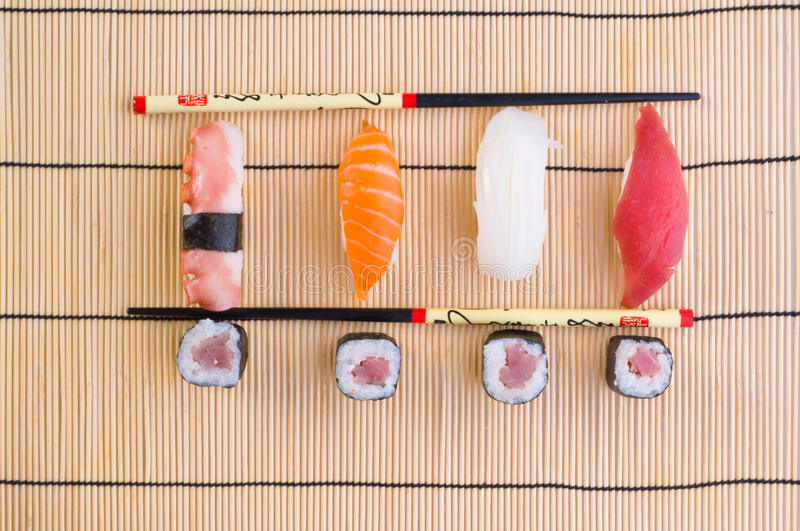 Download Sushi With Chopsticks Royalty Free Stock Photography - Image: 9940027