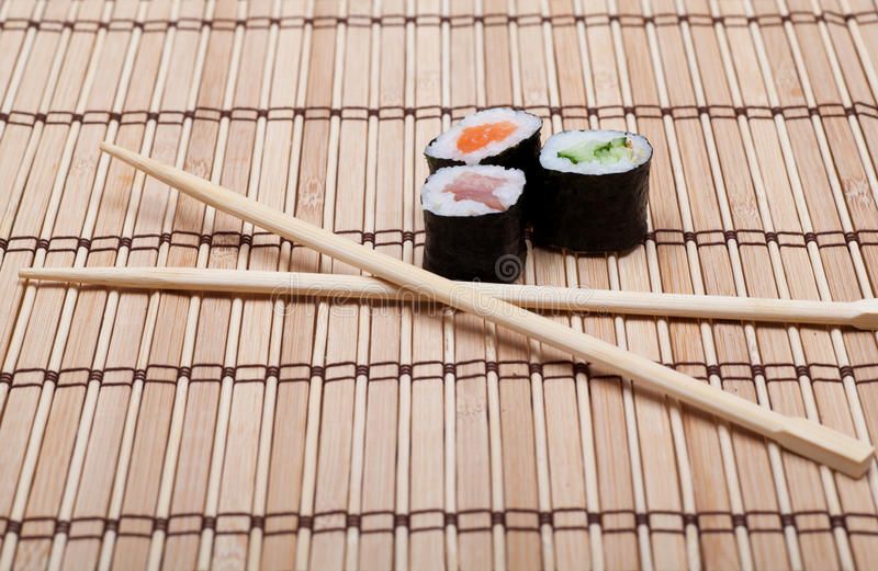 Download Sushi And Chopsticks On Bamboo Mat Stock Image - Image: 27160299