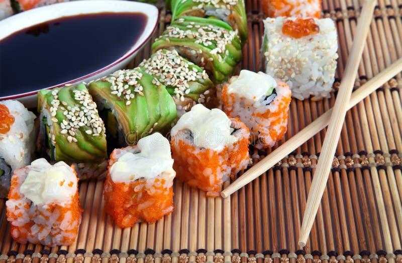 Sushi collection. Sushi. Closeup japanese sushi on a bamboo napkin. Sushi collection stock photos
