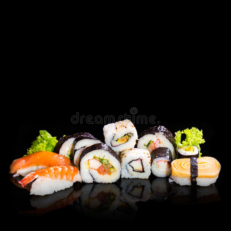 Sushi collection, isolated on black background. Food. Cuisine royalty free stock images