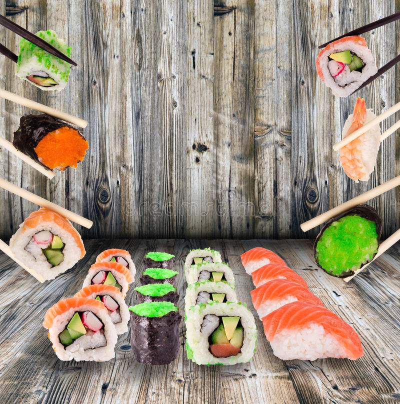 Sushi collection. Over wooden background royalty free stock photos