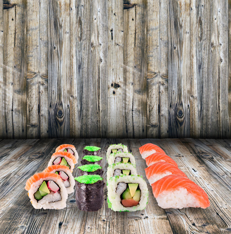 Sushi collection. Over wooden background stock image