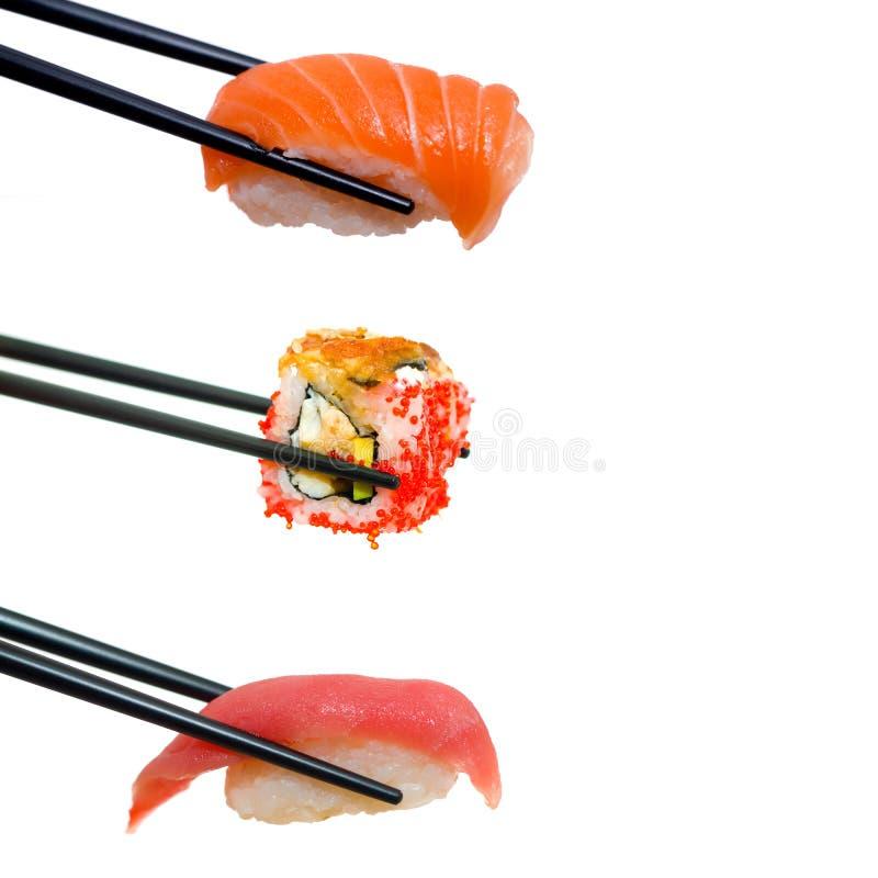 Sushi con los palillos fotos de archivo libres de regalías