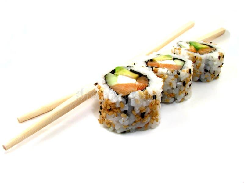 Sushi con los palillos foto de archivo libre de regalías