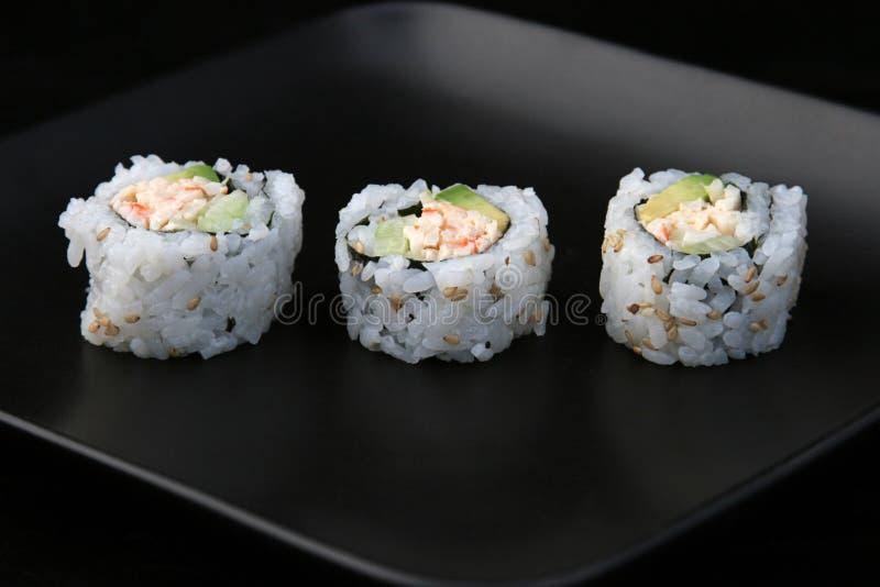 Sushi de la plaque noire 1 photo stock