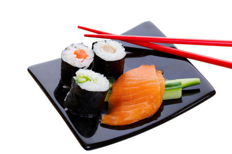 Sushi dish. On a white background with red chopsticks royalty free stock photography