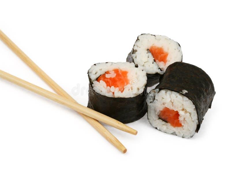Sushi e bacchette su bianco fotografia stock libera da diritti