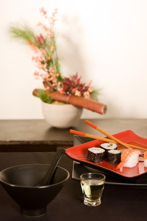 Sushi e ikebana fotografia de stock