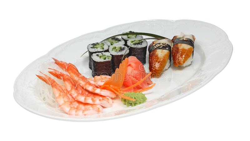 Sushi with eel and rolls with cucumber and nori. Shrimps, rice noodle, ginger and wasabi on white oval plate stock photos
