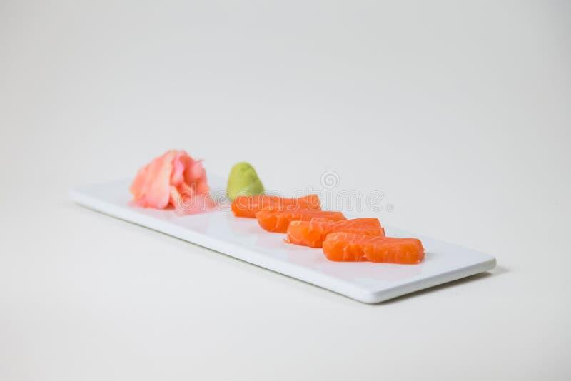 Sushi em uma placa branca em um fundo branco isolado foto de stock royalty free