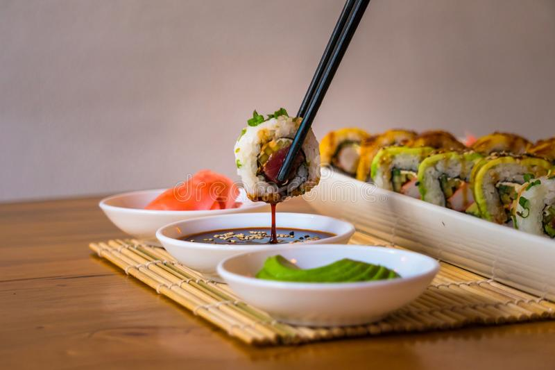 Delicious Sushis, with avocado and white plates royalty free stock photos