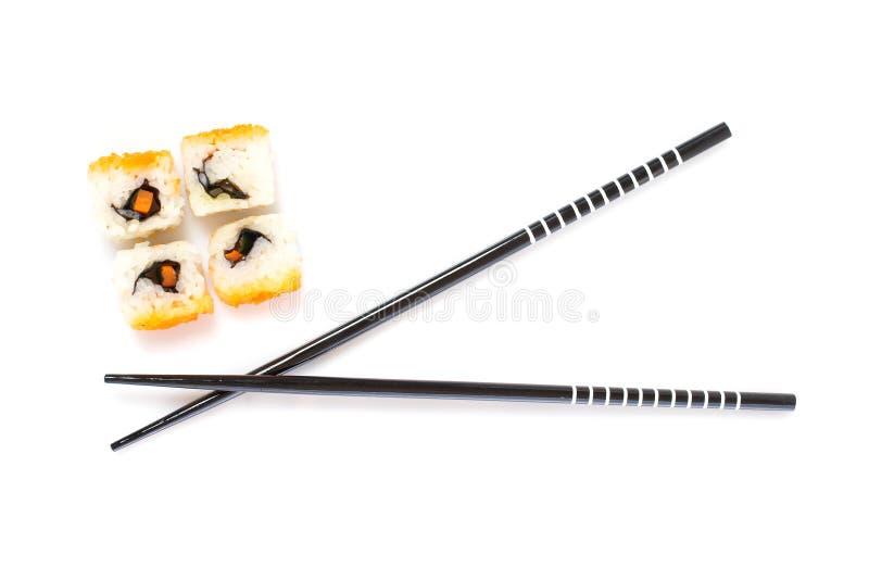 Sushi et baguettes image stock