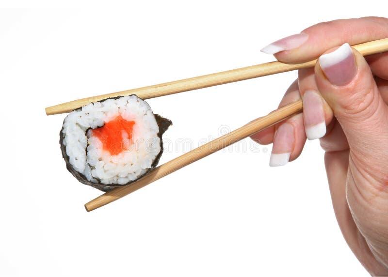 Sushi femenino de la explotación agrícola de la mano fotos de archivo libres de regalías