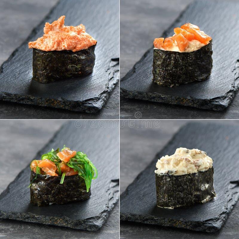 Sushi figés gunkan et temaki des saumons, thon, période de jeu sur le fond noir Cuisine japonaise traditionnelle images libres de droits