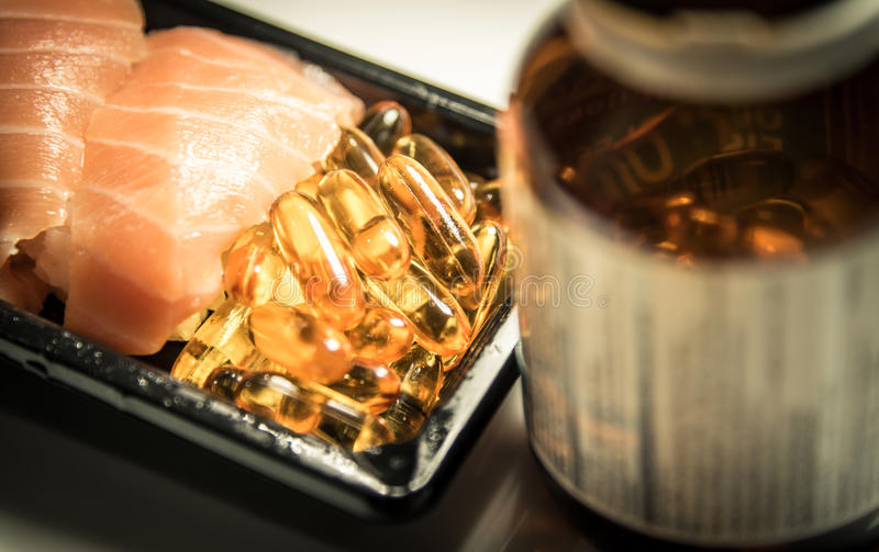 Sushi and fish oil capsules food supplement royalty free stock images