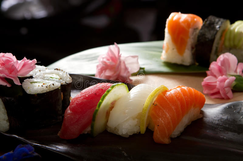 Sushi with flowers and banana leaf royalty free stock images