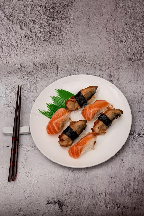Sushi on the gray cement background. Closeup of sushi isolated on gray cement background stock photo