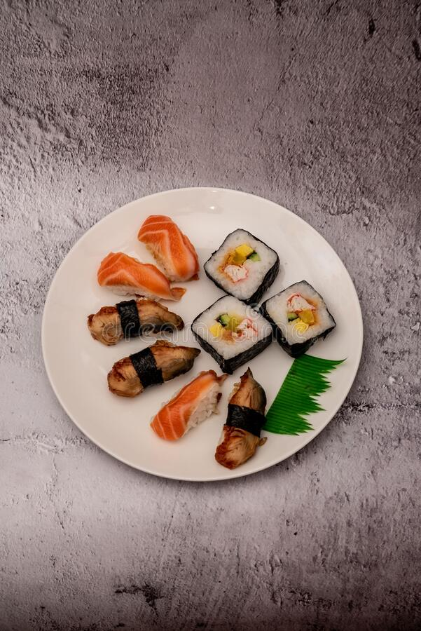 Sushi on the gray cement background. Closeup of sushi isolated on gray cement background royalty free stock photos