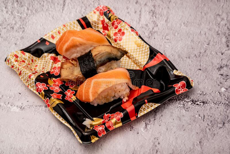 Sushi on the gray cement background. Closeup of sushi isolated on gray cement background royalty free stock photo
