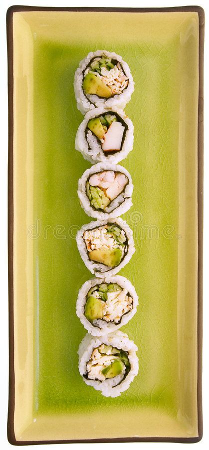 Sushi on a green plate isolated on white royalty free stock photo