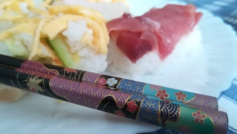 Sushi and hashi royalty free stock photography