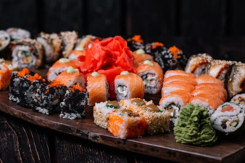 Sushi large set for big party on wood background. Sushi large set for big party on dark wood background stock photo