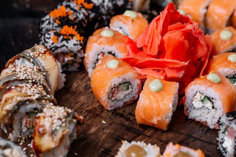 Sushi large set on wood background. Sushi large set on dark wood background stock photos