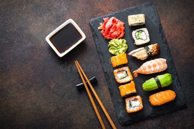 Sushi, maki, nigiri and sushi roll set top view royalty free stock photos