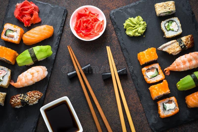Sushi, maki, nigiri and sushi roll set top view royalty free stock photo