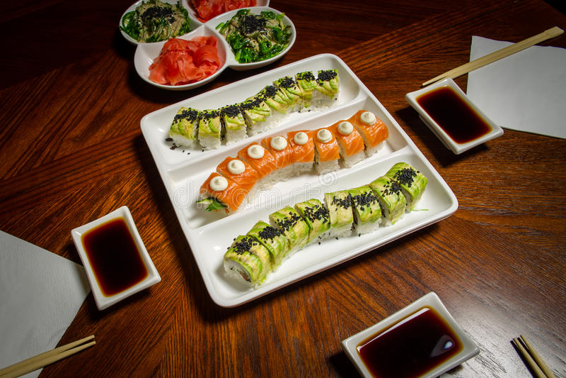 Sushi maki&rolls table setting royalty free stock image