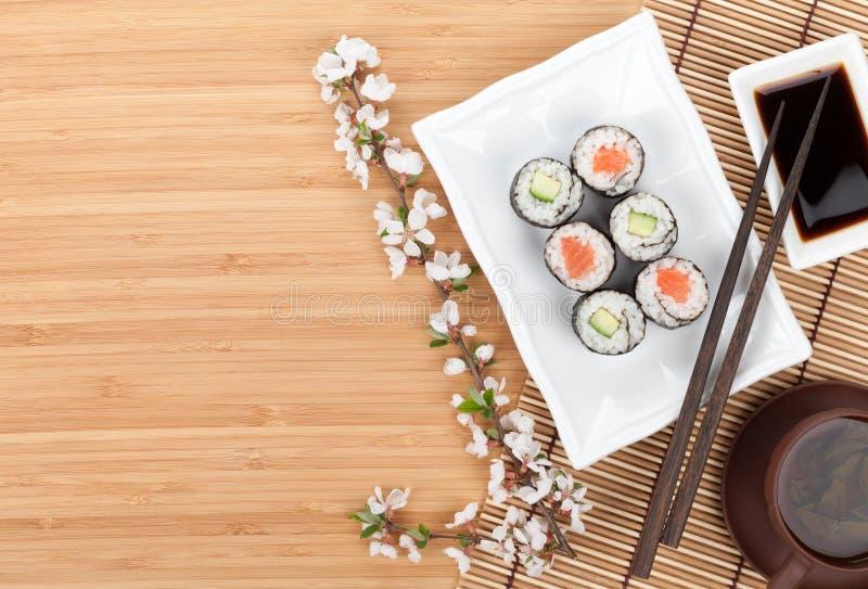 Sushi maki set with fresh sakura branch stock images