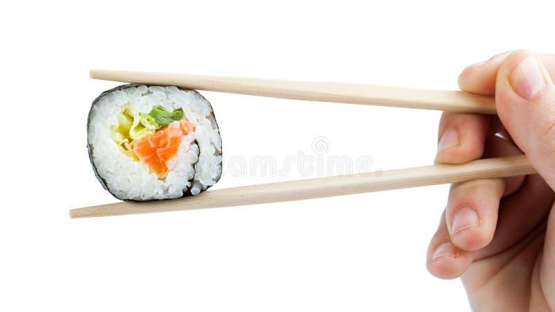 Sushi med pinnar arkivfoto