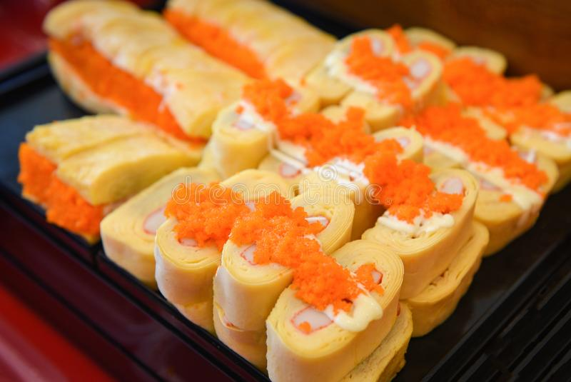 Sushi menu set Japanese cuisine fresh ingredients on tray - Japanese food sushi roll rice crab stick omelet with Tobiko egg is royalty free stock photography