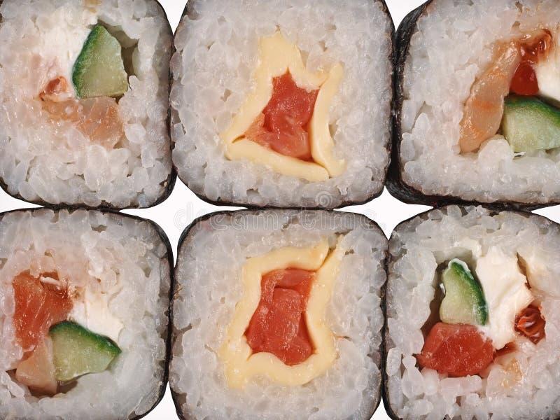 Sushi, nigiri del sashimi e rotoli di maki fotografia stock