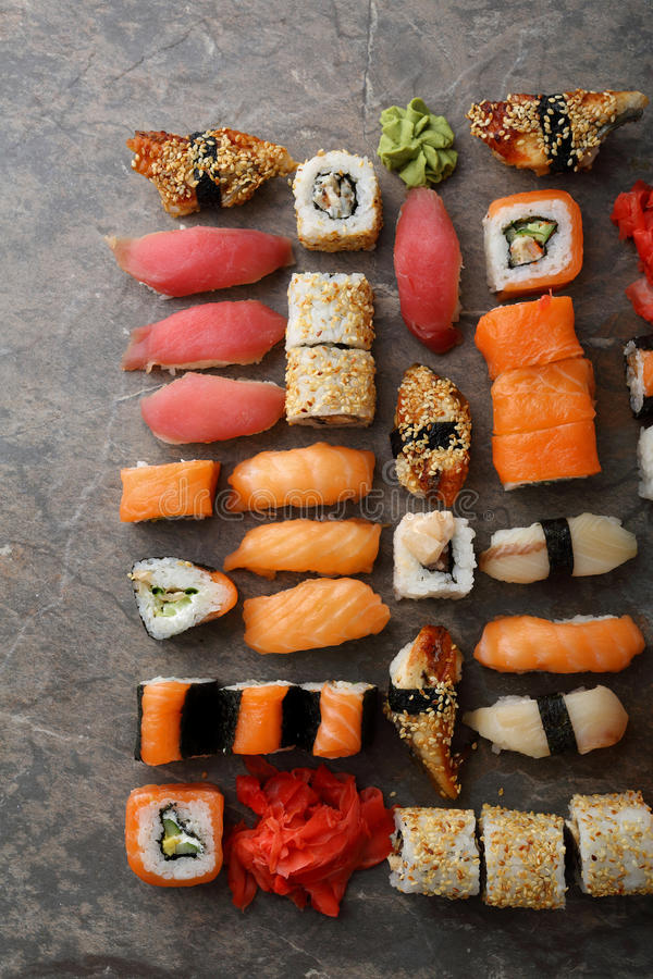 Sushi and nigirin set pattern on slate. Food above royalty free stock image