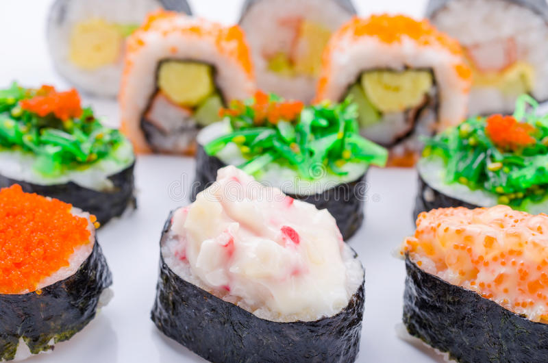 Sushi pieces collection. On white background royalty free stock photo