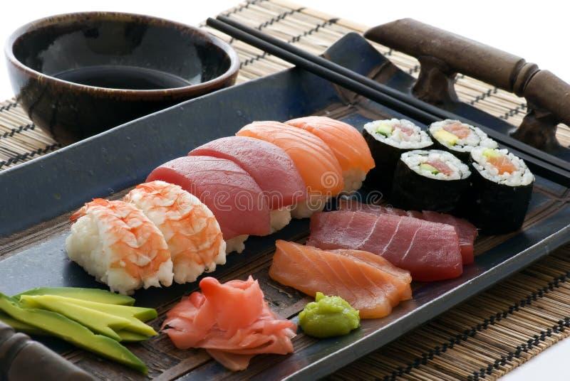 Sushi plate. Maki, Nigiri and Sashimi Sushi on a plate well prepared stock images