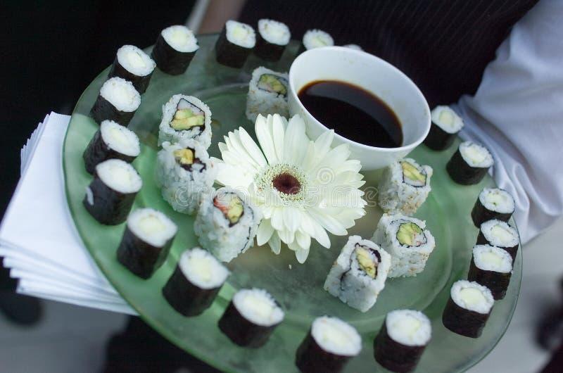 Sushi platter. Sushi on plate flower green plate stock photo