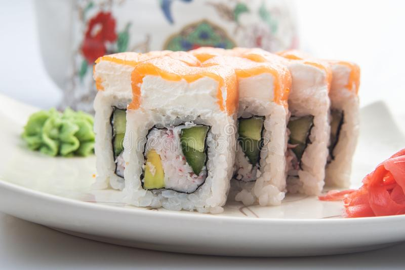 Sushi platter isolated on white background. Japanese food restaurant delivery - maki california rolls big party set, top stock photography