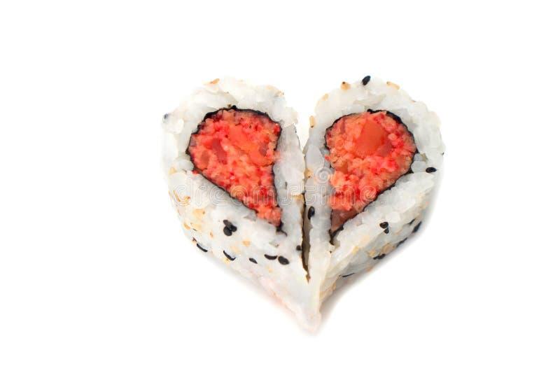 Sushi que forma concepto del amor de la forma del corazón imagenes de archivo