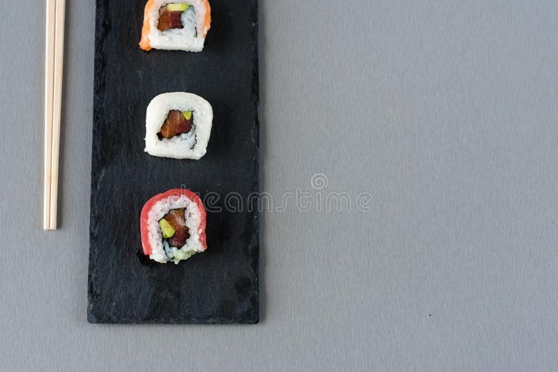 Sushi ready to eat on slate plate royalty free stock photo