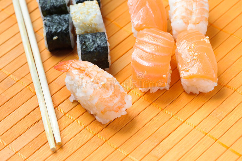 Sushi roll. Traditional Japanese food Sushi. Closeup japanese sushi on a bamboo napkin. Sushi collection royalty free stock photos