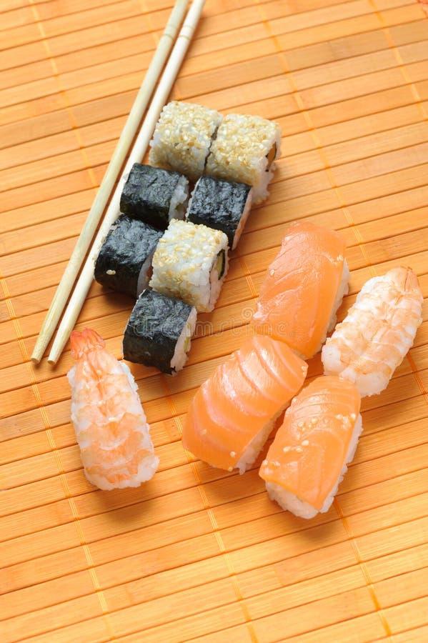 Sushi roll. Traditional Japanese food Sushi. Closeup japanese sushi on a bamboo napkin. Sushi collection stock photography