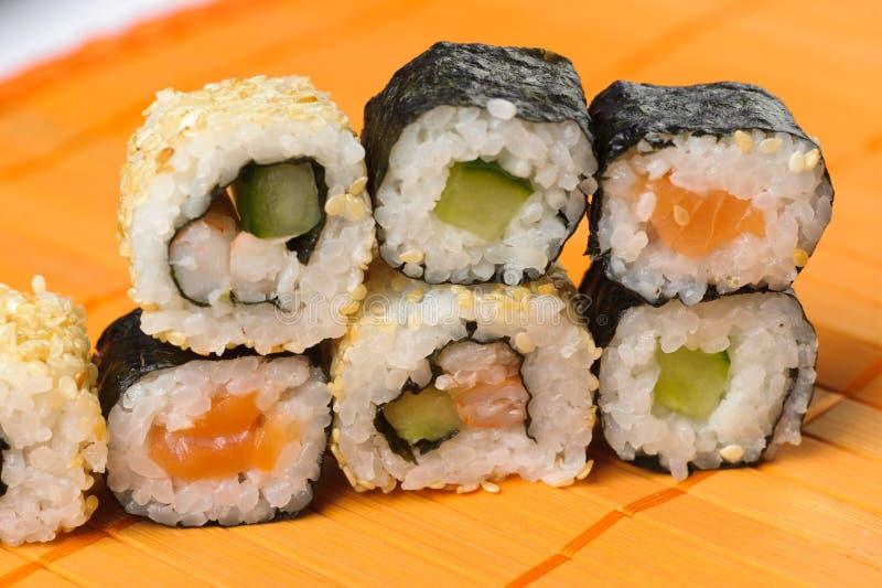 Sushi roll. Traditional Japanese food Sushi. Closeup japanese sushi on a bamboo napkin. Sushi collection stock image