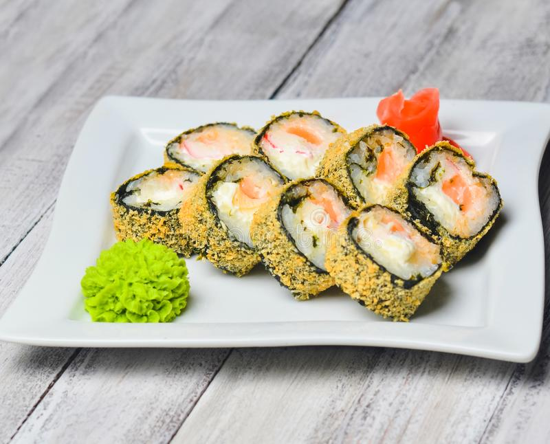 Sushi roll banzai close up. Hot roll philadelphia with shrimp royalty free stock photos
